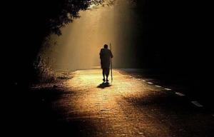 a man walking by himself into light